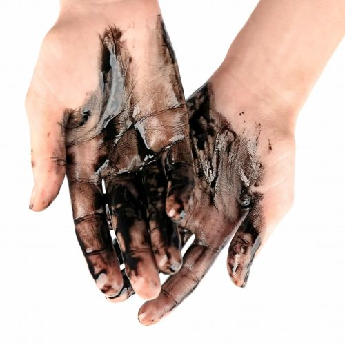 Human hands with oil on white background